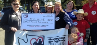 Farmers standing behind banner for Washington's Beef Community group