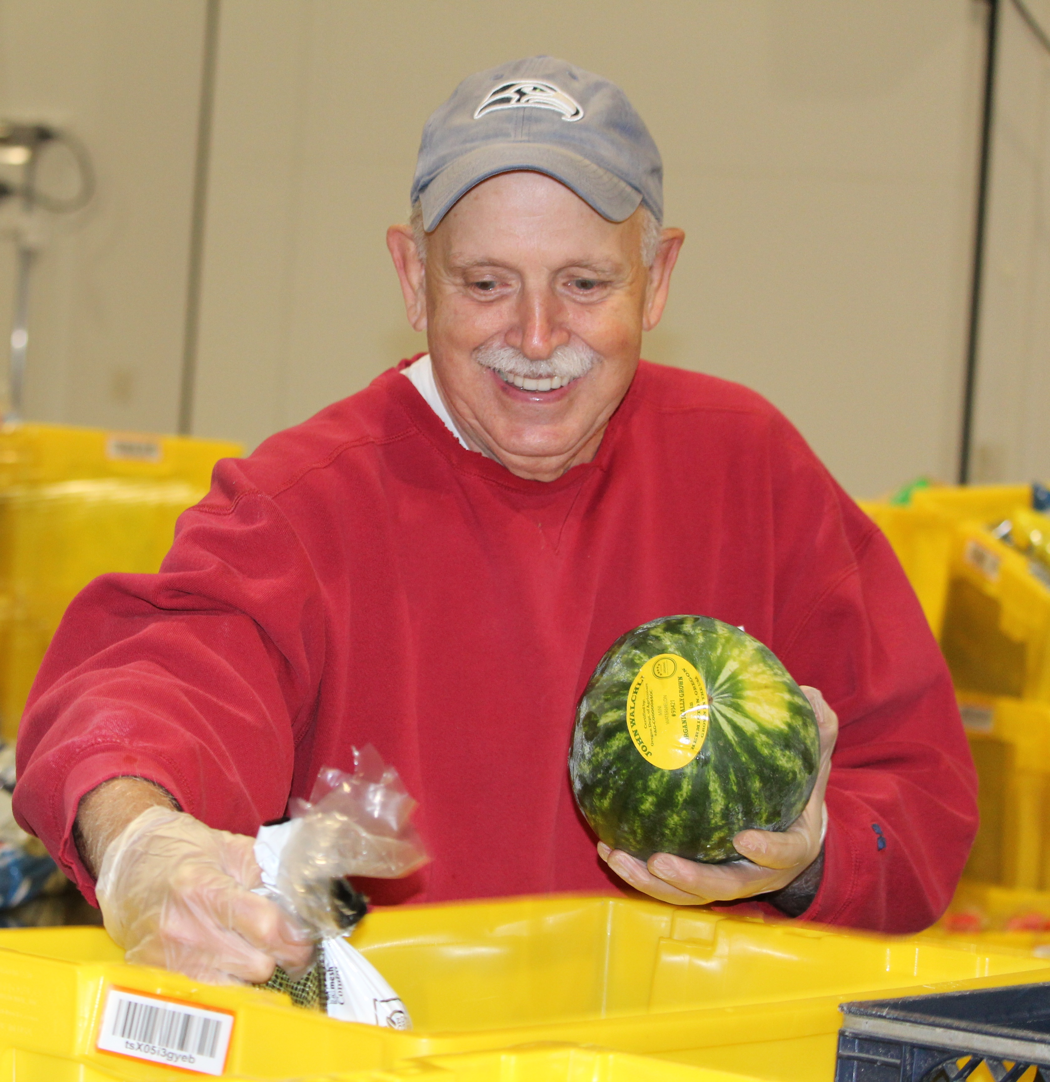 Smiling volunteer holding a watermelon
