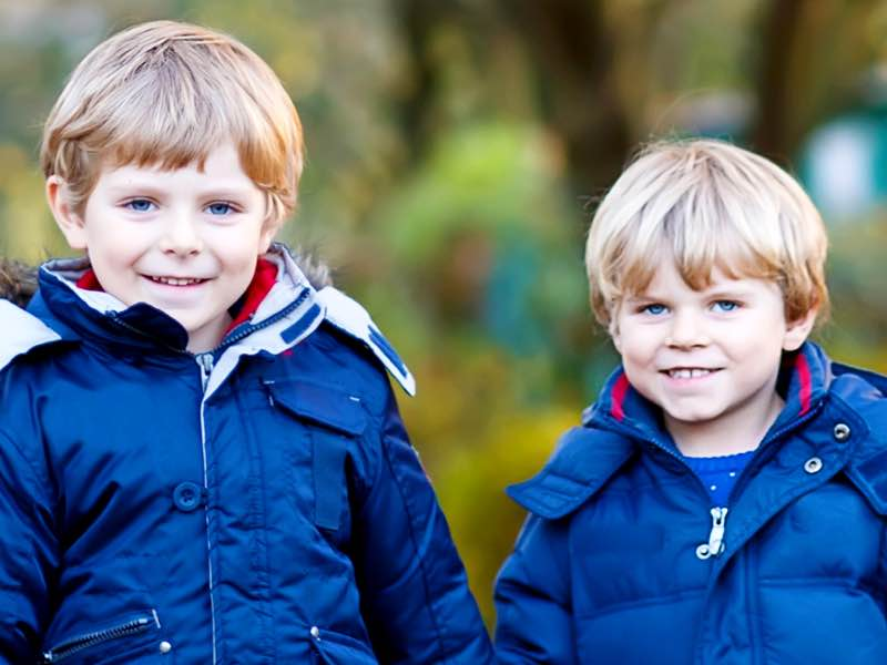 two boys in winter coats